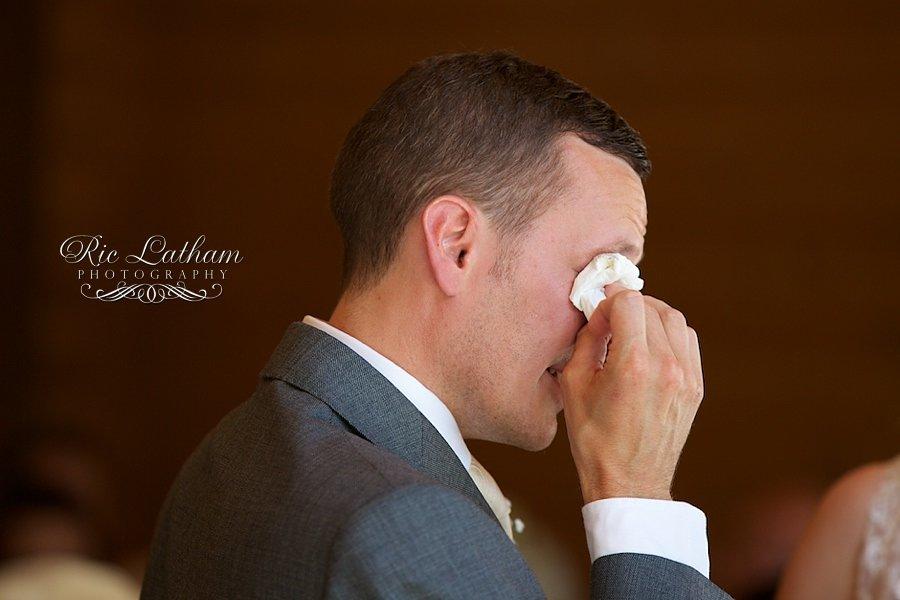 emotional groom with a handkercheif