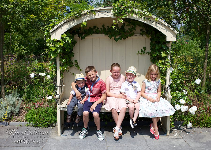 children at a wedding on a bench