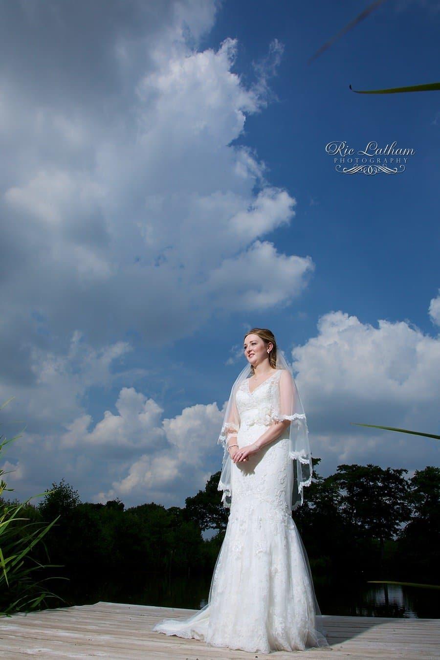 bride in a blue cloudy sky