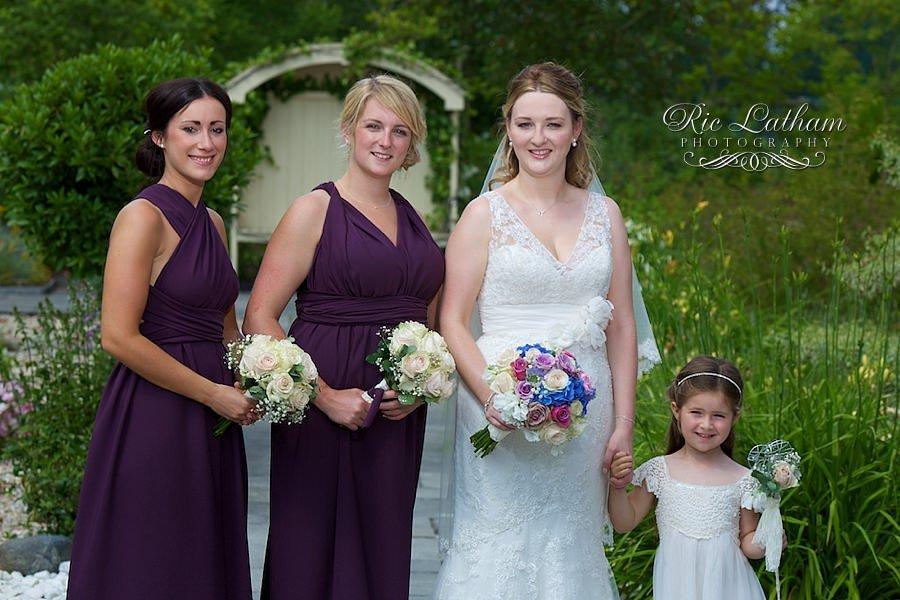 bride with her bridesmaids, purple bridesmaids dresses