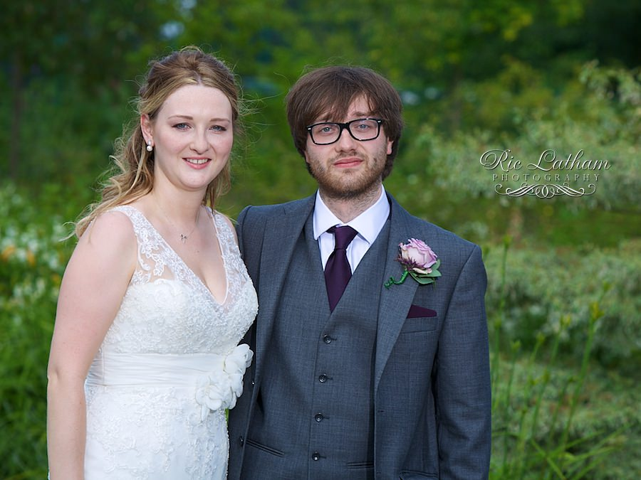 Bride and her brother with pink flower