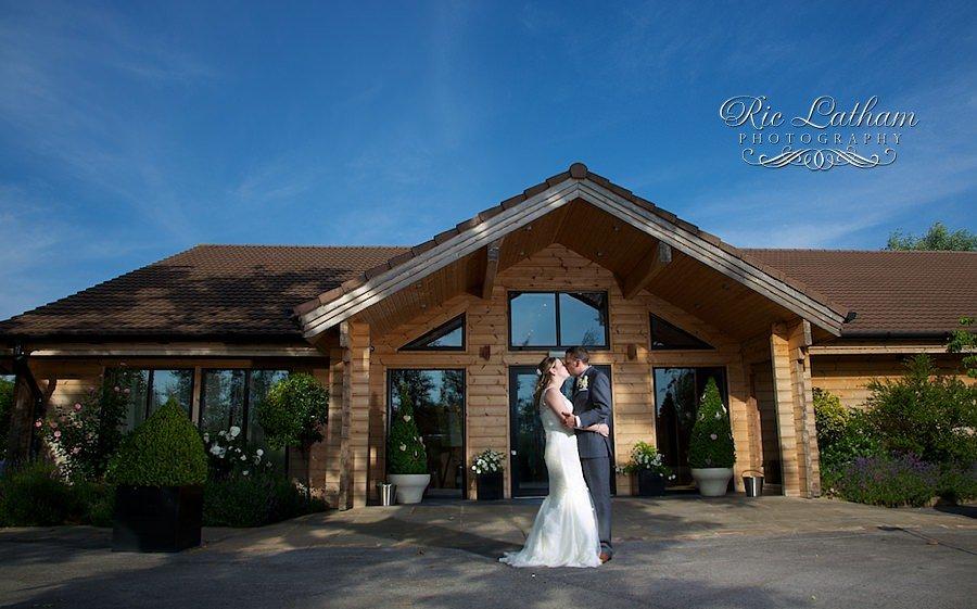 bride ad groom kissing at styal lodge
